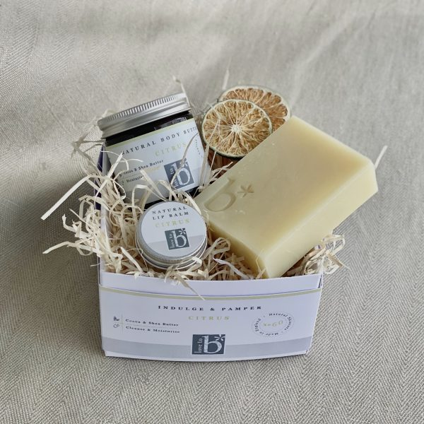Natural citrus pamper box In a white box with a brown material background