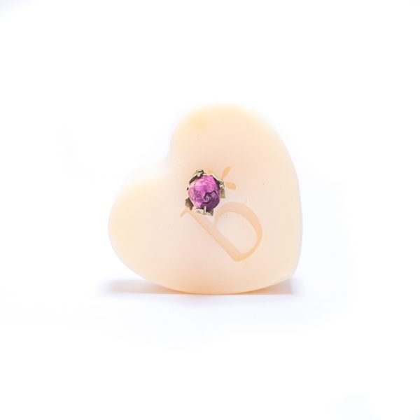 Natural rose heart soap with rose bud and a white background