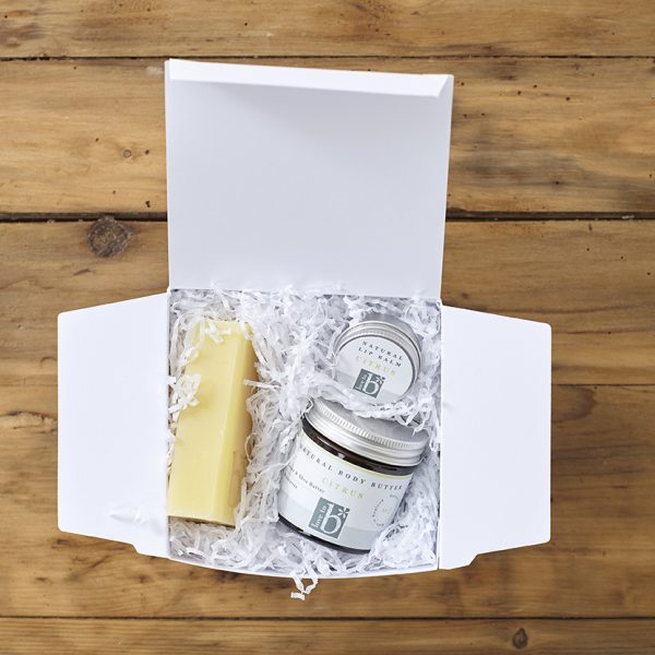 White Natural citrus indulge and pamper gift box on a wooden background