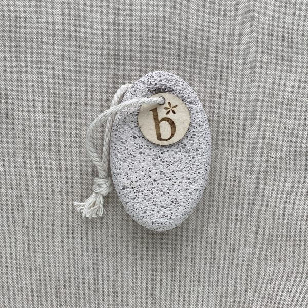 Grey Natural pumice stone with a string to hang it on with a grey background