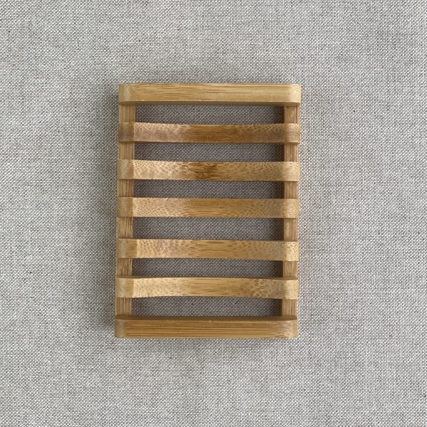 Rectangular Sustainably sourced bamboo slatted soap dish on a brown linen background
