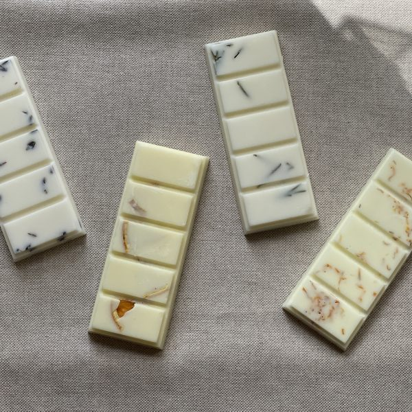 Relax, Energise, Meditate and Hope natural soy wax melts arranged on a brown material background